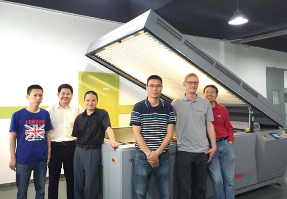 From left to right: Huang Chaobo (Kunshan Fuhua), Supachai Theravithayangkura (Flint Group), Li Lin (Kunshan Fuhua), Yushan Lee, Thomas Weik, and Sim Cai (Flint Group) are pleased with the installation of a nyloflex® NExT Exposure at Kunshan Fuhua.